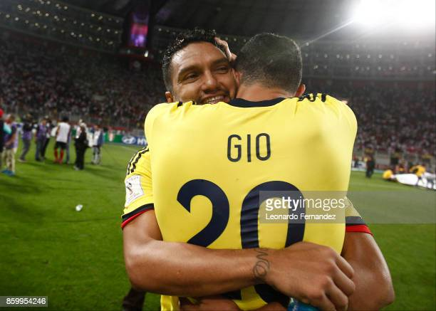 Abel Aguilar of Colombia celebrates with teammate Giovanni Moreno the qualifying to the World Cup Russia 2018 after the match between Peru and...
