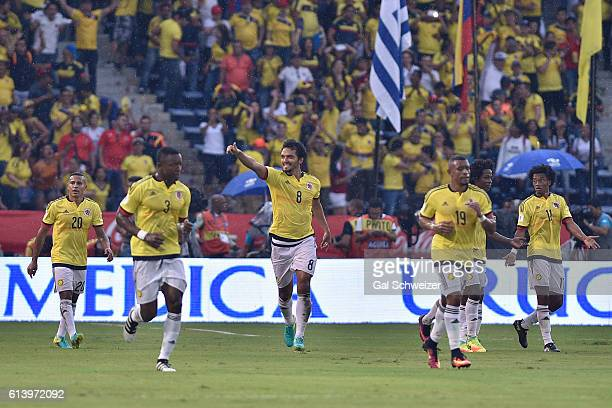 Abel Aguilar of Colombia celebrates with teammates after scoring the opening goal during a match between Colombia and Uruguay as part of FIFA 2018...