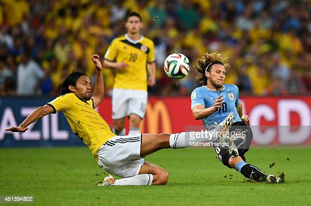 Abel Aguilar of Colombia challenges Diego Forlan of Uruguay during the 2014 FIFA World Cup Brazil round of 16 match between Colombia and Uruguay at...