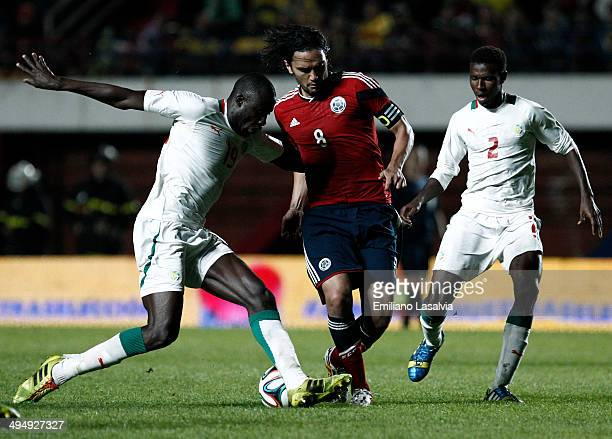 Abel Aguilar of Colombia fights for the ball with Cheikh Tidiane Ndoye and Ousseynou Thioune of Senegal during the International Friendly match...