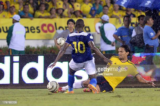 Abel Aguilar of Colombia fights for the ball with Walter Ayovi of Ecuador during a match between Colombia and Ecuador as part of the 15th round of...