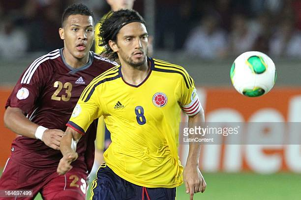 Abel Aguilar of Colombia fithgs for the ball with Jose Salome Rondon of Venezuela during a match between Venezuela and Colombia as part of the 12th...