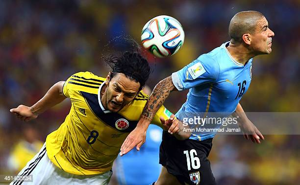 Abel Aguilar of Colombia in action against Maximiliano Pereira of Uruguay during the 2014 FIFA World Cup Brazil round of 16 match between Colombia...