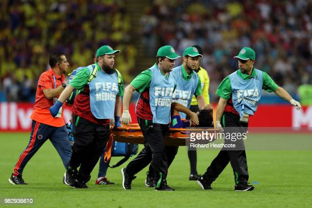 Abel Aguilar of Colombia is carried off the pitch on a stretcher during the 2018 FIFA World Cup Russia group H match between Poland and Colombia at...