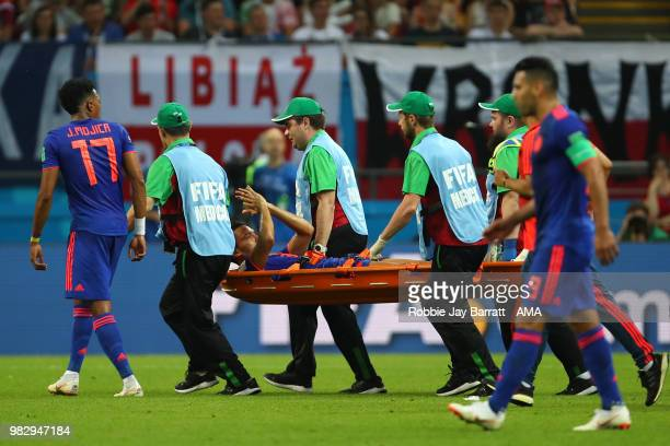 Abel Aguilar of Colombia is stretchered off during the 2018 FIFA World Cup Russia group H match between Poland and Colombia at Kazan Arena on June 24...