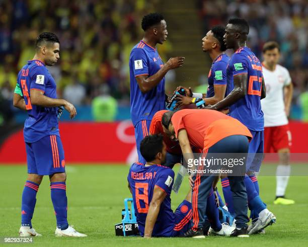 Abel Aguilar of Colombia receives medical treatment during the 2018 FIFA World Cup Russia group H match between Poland and Colombia at Kazan Arena on...