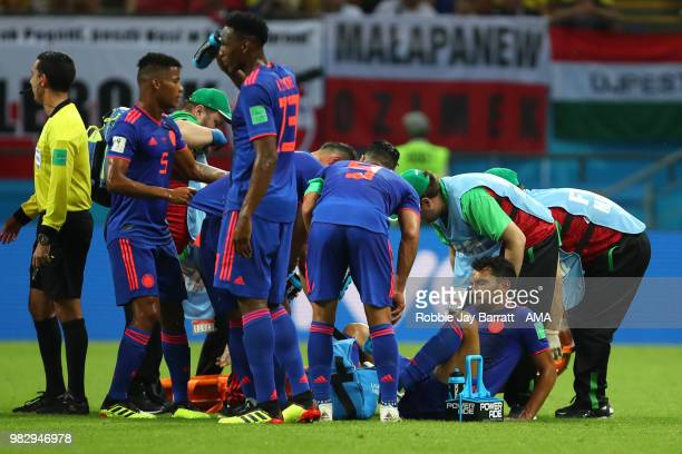 Abel Aguilar of Colombia receives treatment for an injury during the 2018 FIFA World Cup Russia group H match between Poland and Colombia at Kazan...