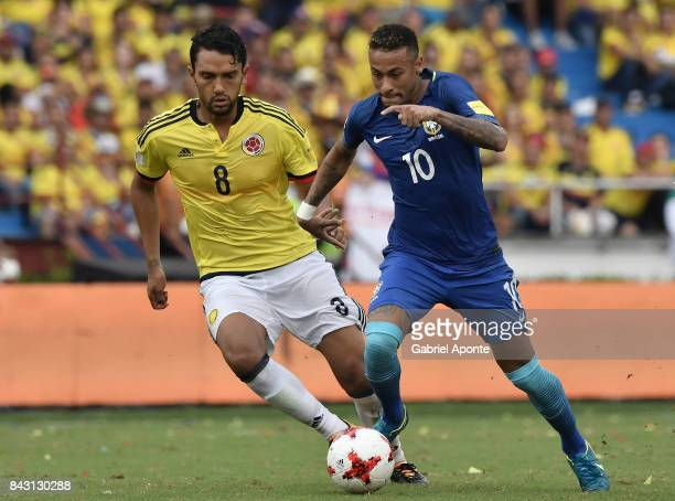 Abel Aguilar of Colombia struggles for the ball with Neymar Jr of Brazil during a match between Colombia and Brazil as part of FIFA 2018 World Cup...