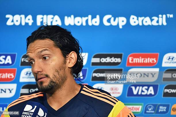 Abel Aguilar of Colombia talks to a reporter in the mixed zone after the 2014 FIFA World Cup Brazil Group C match between Colombia and Cote D'Ivoire...
