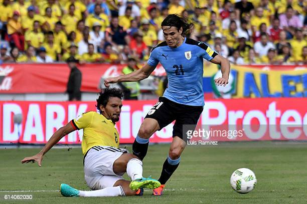 Abel Aguilar of Colombia vies for the ball with Edinson Cavani of Uruguay during a match between Colombia and Uruguay as part of FIFA 2018 World Cup...