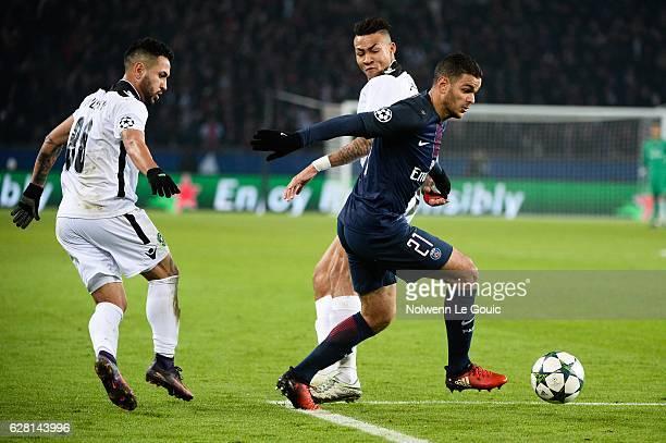 Abel Anicet of Ludogorets and Hatem Ben Arfa of PSG during the Champions League match between Paris Saint Germain and Ludogorets Razgrad at Parc des...