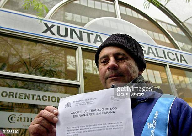 Abel Doqueiras de Olindas shows a request form from the Spanish embassy to obtain a Spanish work visa 23 July 2001 in Buenos Aires Argentina...