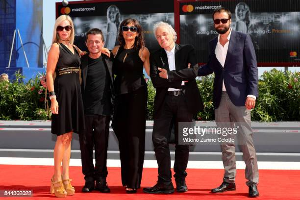 Abel Ferrara and guests walk the red carpet ahead of the 'Il Signor Rotpeter' and 'Piazza Vittorio' screening during the 74th Venice Film Festival at...