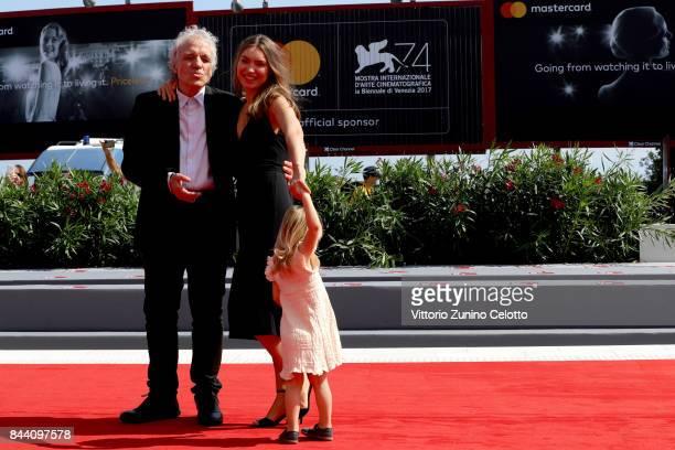 Abel Ferrara Christina Chiriac Ferrara and Anna Ferrara walk the red carpet ahead of the 'Il Signor Rotpeter' and 'Piazza Vittorio' screening during...