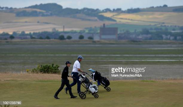 Abel Gallegos of Argentina and Jayden Ford of New Zealand walk together at the 7th hole during the final day of the The Junior Open Championship at...