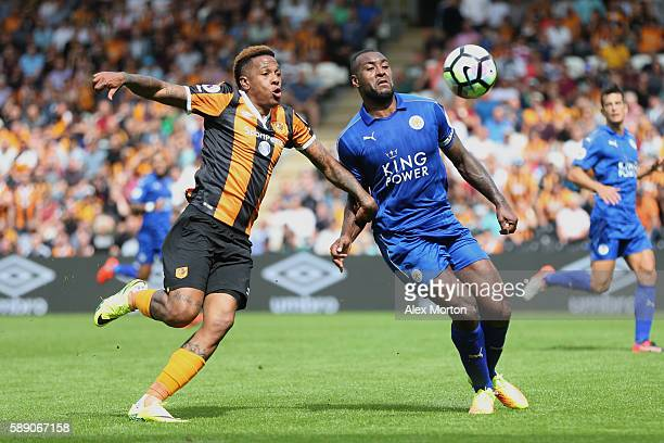 Abel Hernandez of Hull City and Wes Morgan of Leicester City battle for possession during the Premier League match between Hull City and Leicester...