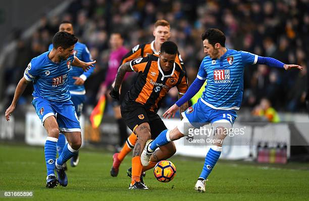 Abel Hernandez of Hull City attempts to take the ball past Adam Smith of AFC Bournemouth and Andrew Surman of AFC Bournemouth during the Premier...
