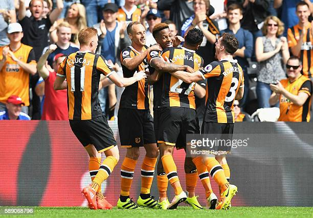 Abel Hernandez of Hull City celebrates scoring his sides first goal with his team mates during the Premier League match between Hull City and...