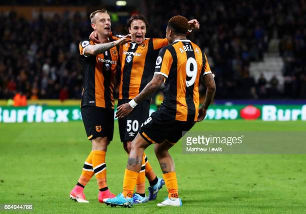 Abel Hernandez of Hull City celebrates scoring his sides third goal with his Hull City team mates during the Premier League match between Hull City...