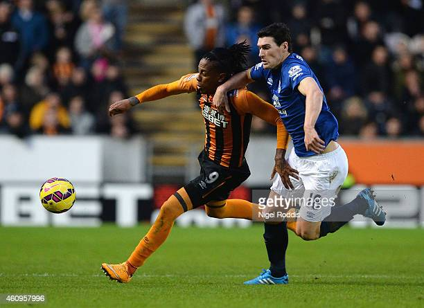 Abel Hernandez of Hull City is challenged by Gareth Barry of Everton during the Barclays Premier League match between Hull City and Everton at KC...