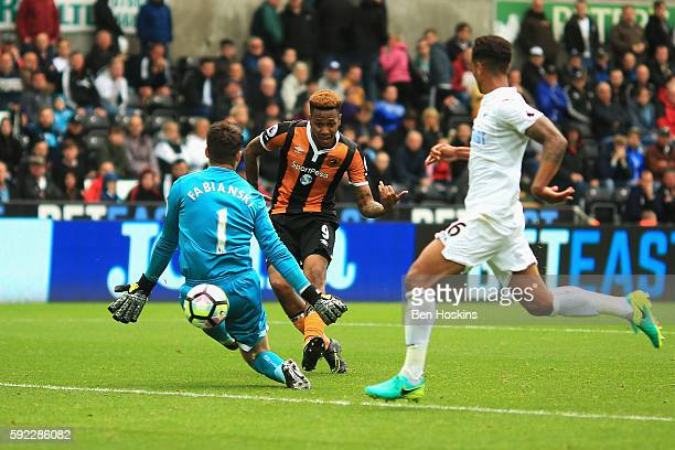 Abel Hernandez of Hull City scores his sides second goal during the Premier League match between Swansea City and Hull City at Liberty Stadium on...