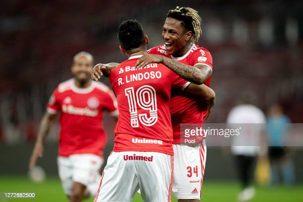 Abel Hernandez of Internacional celebrates after scoring the third goal of his team with teammate Rodrigo Lindoso during a group E match of Copa...