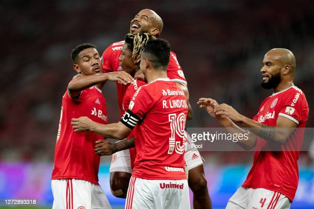 Abel Hernandez of Internacional celebrates after scoring the third goal of his team with teammate during a group E match of Copa CONMEBOL...