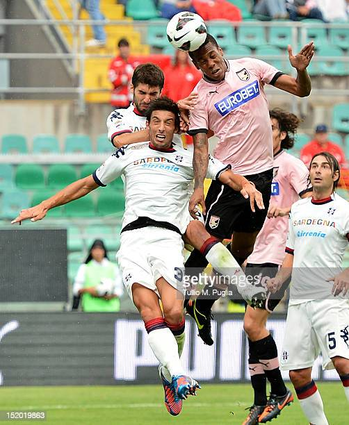 Abel Hernandez of Palermo and Lorenzo Ariaudo and Luca Rossettini of Cagliari jump for the ball during the Serie A match between US Citta di Palermo...