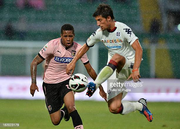 Abel Hernandez of Palermo and Lorenzo Ariaudo of Cagliari compete for the ball during the Serie A match between US Citta di Palermo and Cagliari...