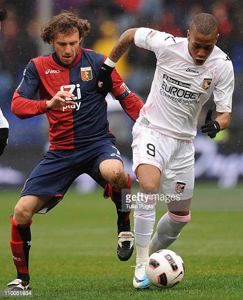Abel Hernandez of Palermo is challenged by Marco Rossi of Genoa during the Serie A match between Genoa CFC and US Citta di Palermo at Stadio Luigi...