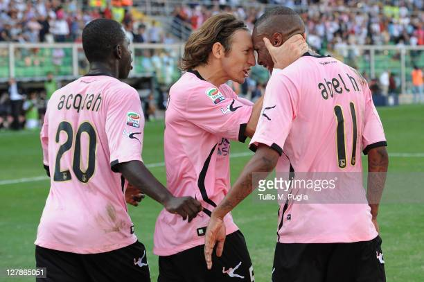 Abel Hernandez of Palermo is congratulated by teammate Edgar Barreto and Afriyie Acquah after scoring a penalty during the Serie A match between US...