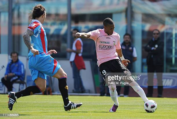 Abel Hernandez of Palermo kicks the ball as Pablo Alvarez of Catania reacts during the Serie A match between Catania Calcio and US Citta di Palermo...