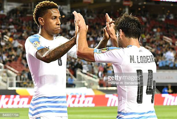 Abel Hernandez of Uruguay is congratulated by Nicolas Lodeiro after Hernandez scored a goal against Jamaica during the 2016 Copa America Centenario...
