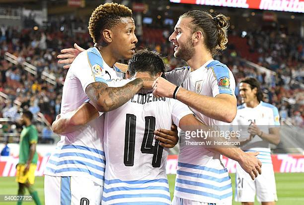 Abel Hernandez of Uruguay is congratulated by Nicolas Lodeiro and Gaston Silva after Hernandez scored a goal against Jamaica during the 2016 Copa...
