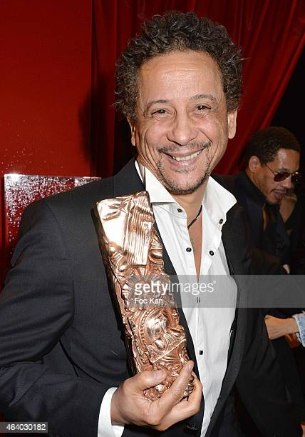 Abel Jafri poses with the Abderrahmane Sissako's award during the Dinner at Le Fouquet's after the Cesar Film Awards 2015 on February 20 2015 in...