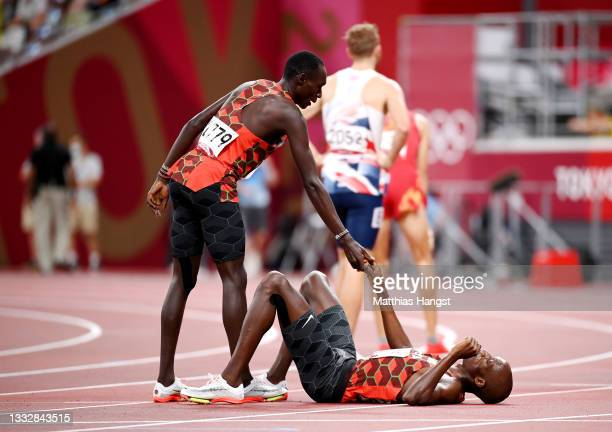 Abel Kipsang reacts with Timothy Cheruiyot of Team Kenya after competing in the Men's 1500m Final on day fifteen of the Tokyo 2020 Olympic Games at...