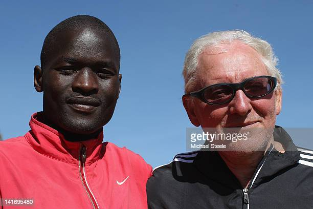 Abel Kirui of Kenya and double world champion in the marathon poses for a portrait with coach Renato Canova after a training run in Angily on...