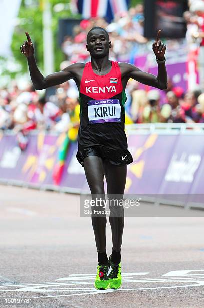 Abel Kirui of Kenya celebrates as he approaches the line to win silver in the Men's Marathon on Day 16 of the London 2012 Olympic Games at The Mall...