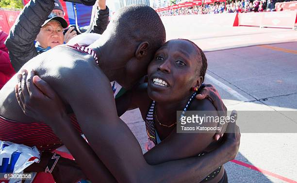 Abel Kirui of Kenya celebrates with Florence Kiplagat of Kenya the winner of the women's race at the Bank of America Chicago Marathon on October 9...