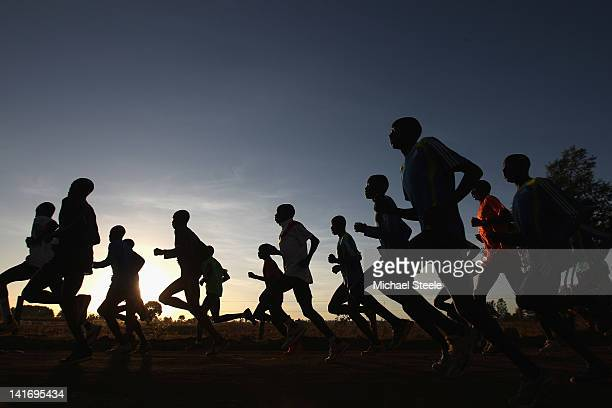 Abel Kirui of Kenya double world champion in the marathon and his group during a training run in Angily on February 4 2012 in Nairobi Kenya