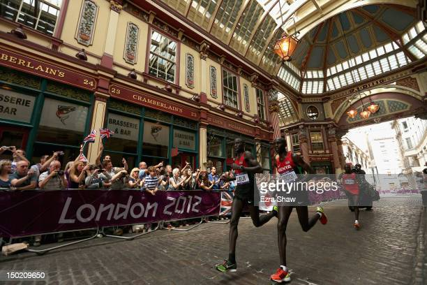 Abel Kirui of Kenya Wilson Kipsang Kiprotich of Kenya and Stephen Kiprotich of Uganda run through Leadenhall Market as they compete in the Men's...
