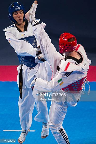 Abel Mendoza of Mexico competes with Conor Grassick or Ireland during a men's 63 kg combat of WTF World Taekwondo Championships 2013 at the...