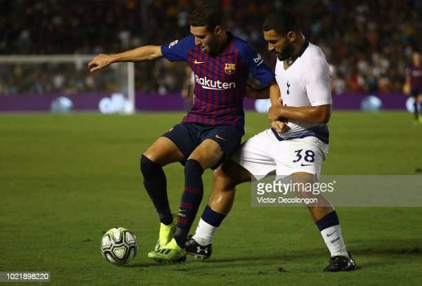 Abel Ruiz of Barcelona holds off a challenge from Cameron CarterVickers of Tottenham Hotspur during the International Champions Cup 2018 match at...