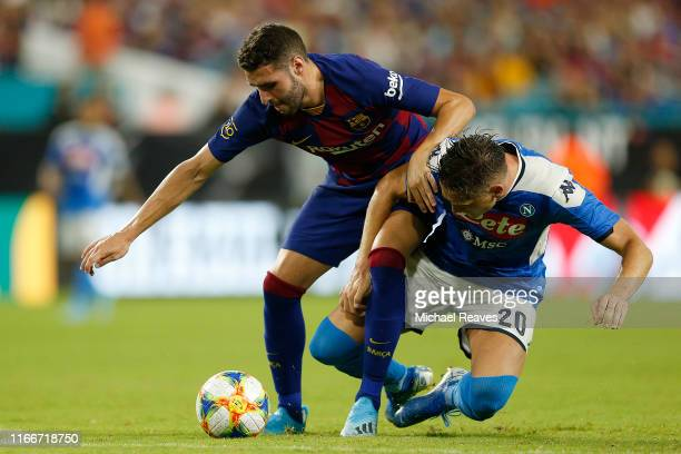 Abel Ruiz of FC Barcelona battles for possession of the ball with Piotr Zielinski of SSC Napoli during the second half of a preseason friendly match...