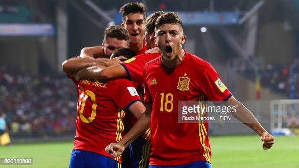 Abel Ruiz of Spain celebrates a scored goal with his teammates during the FIFA U17 World Cup India 2017 Semi Final match between Mali and Spain at Dr...
