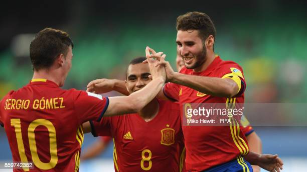 Abel Ruiz of Spain celebrates with team mates after scoring his second goal during the FIFA U17 World Cup India 2017 group D match between Spain and...