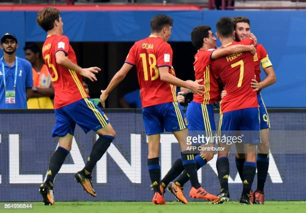 Abel Ruiz of Spain celebrates with teammates after scoring a goal against Iran during their quarterfinal football match of the FIFA U17 World Cup at...