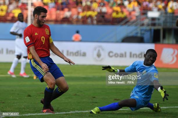 Abel Ruiz of Spain slides the ball past Khaled Lawali of Niger to open the scoring during the FIFA U17 World Cup India 2017 group D match between...