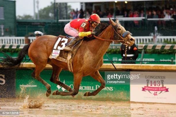 Abel Tasman ridden by jockey Mike Smith crosses the finish line to win the 143rd running of the Kentucky Oaks at Churchill Downs on May 5 2017 in...