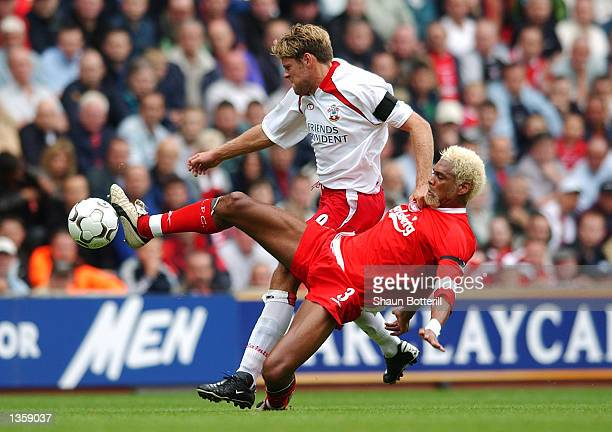 Abel Xavier of Liverpool tackles James Beattie of Southampton during the FA Barclaycard Premiership match between Liverpool and Southampton at...